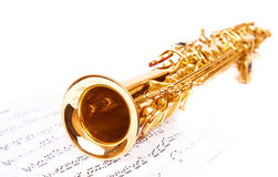 Musical notes and saxophone. Isolated on white stock image