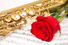 Musical notes and saxophone Royalty Free Stock Photography