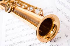 Musical notes and saxophone. On white Stock Photos
