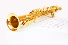 Musical notes and saxophone Stock Photography