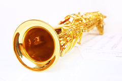 Musical notes and saxophone. On a white background Royalty Free Stock Photo