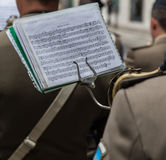 Musical notes. Sheet music with musical notes on the lectern stuck to a musical instrument Stock Photo