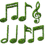 Musical notes, symbol made from green leaves isolated on white background. 3d render Stock Images
