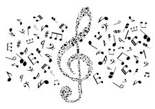 Musical notes and symbols in shape of treble clef Royalty Free Stock Photo