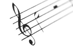 Musical notes and treble clef. Stock Photography