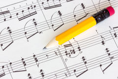 Musical notes with yellow pencil stock photos