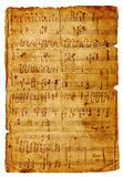 Musical page. Old musical tattered page with handwritings Stock Image