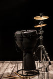 Musical percussion instruments on black background royalty free stock photo