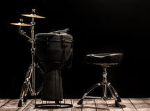 Musical percussion instruments on black background royalty free stock images