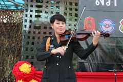 Musical performance of military musicians. Playing violin Outdoor patio To the public stock photography