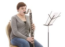 Musical Performance. Teen playing the bass clarinet.  Isolated on white Stock Photo