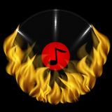 Musical plate and fire. On a black background Stock Image