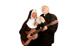 Musical Priest and Nun Stock Images