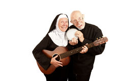 Musical Priest and Nun Royalty Free Stock Photography