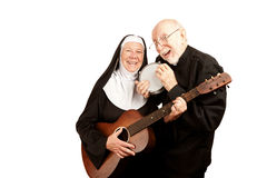 Musical priest and nun Royalty Free Stock Photo