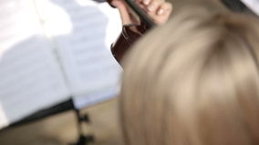 Musical quartet. Violinist player. Medium shot. Musical quartet. Three violinists and cellist playing music. SESSION KEYWORD: uzhursky003 stock footage