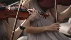 Musical quartet. Violinist plays against the sky. Close up. Musical quartet. Three violinists and cellist playing music. SESSION KEYWORD: uzhursky003 stock video