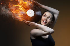 Musical record. She held in her hand musical record Stock Photography