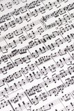 Musical Score. A complicated musical score lies slightly angled across the table Royalty Free Stock Images