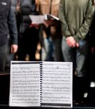 Musical score for a choir performance stock photo