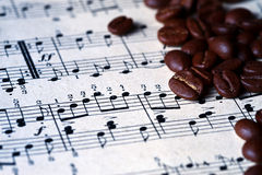 Musical score with coffee beans on it Stock Photography