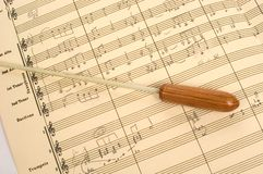 Musical Score with Conductor's Baton. Hand written Musical score (partial) with a conductor's baton laying across the score Stock Photography