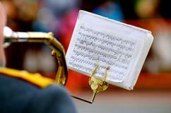 The musical score musician. A musician plays the trumpet.The tool is attached to a sheet with notes Stock Photo