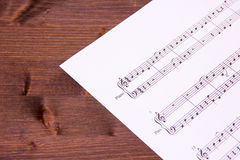 Musical score on wood Stock Photo