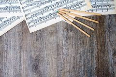 Musical scores with pencils stock image