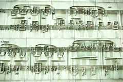 Musical sculpture in Warsaw library wall. Sculpture with musical notes in pentagram. Locate int he wall of the Warsaw's University library Royalty Free Stock Photography