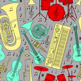 Musical seamless pattern made of different musical instruments, treble clef and notes.  Stock Images