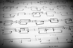 Notes and musical staves. Musical staves with five horizontal lines and different notes. Black and white photo Royalty Free Stock Image