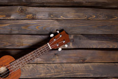 Musical string instrument ukulele. On wooden background Royalty Free Stock Photos
