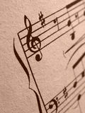 Musical symbols. Musical note sheet fragment as art background Stock Photos