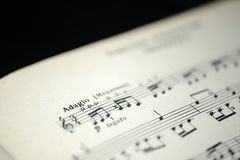 Free Musical Tempo `Adagio` In An Old Music Notebook Royalty Free Stock Images - 104226909