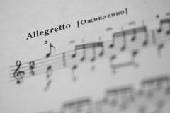 Musical tempo Allegretto in a music book Stock Images