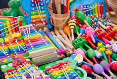 Musical toys and instruments, kids store. Selection of various musical toys and colorful wooden toy instruments for sale at crafts market Stock Photography