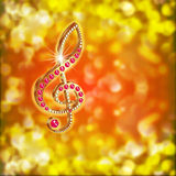 Musical treble clef with precious stones on a bright background Stock Photo