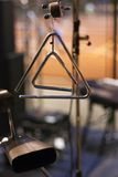 Musical triangle and cowbell. Musical triangles and cowbell at the stage Royalty Free Stock Photo