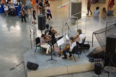 A Musical Troupe Performs inside the Crosstown Concourse, Memphis, Tennessee. A Musical Troupe performs at the annual 901 Day inside the Crosstown Concourse royalty free stock photo