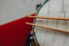 Musical wooden drumsticks on the drum close-up with cope space.  stock photo