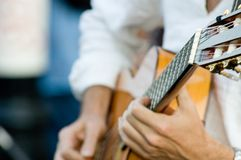 Musican. A musician playing guitar Royalty Free Stock Photography