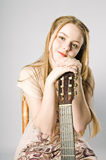 Musician. Portrait of a young women with the guitar stock images