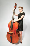 Musician. With double bass. Studio shot stock photo