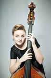 Musician. Young woman with double bass stock photo