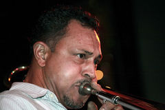 Musician. Jose Rivera performing with a trombone at a New York City nightclub. He is Puerto Rican and was playing Salsa music at the time of the performance Stock Photos