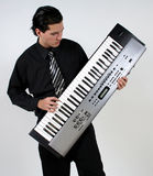 Musician. A man at play on his keyboard royalty free stock photography