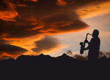 Musician. Silhouette of sax player in a beautiful sunset Stock Photography