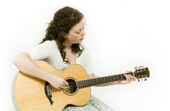 Musician. Young woman singing and playing an acoustic guitar stock photo