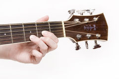 Musician. Young woman playing a chord on an acoustic guitar stock photography